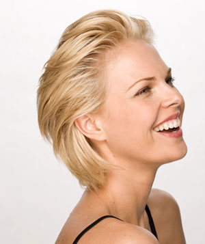 Smiling blonde model with short easy swept back hairdo