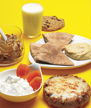 Skim milk, corn flakes, cottage cheese, english muffin, pita and hummus