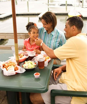Family eating at marina