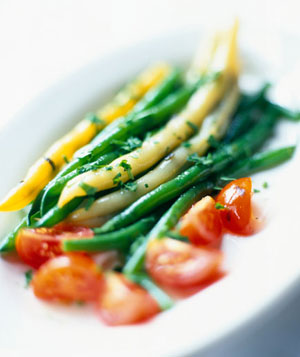 Yellow and green string beans with cherry tomatoes