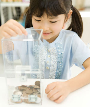 Girl placing money into donation box