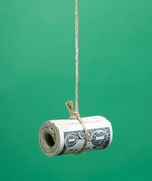 Roll of money hanging from string