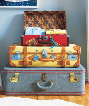 Stack of colorful vintage suitcases