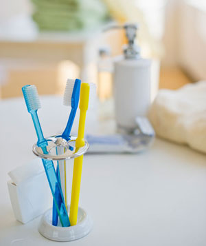Toothbrushes in toothbrush holder
