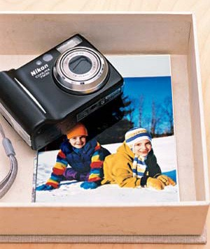 Camera and photograph of children playing in the snow