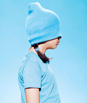 Girl with blue knit hat pulled over her eyes