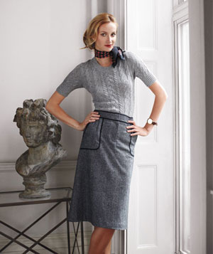 Model wearing straight gray skirt, gray cable knit sweater, Michael Stars scarf and Timex watch