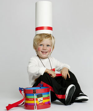 Boy dressed in marching band drummer costume
