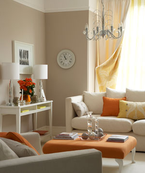 Neutral living room with orange accents