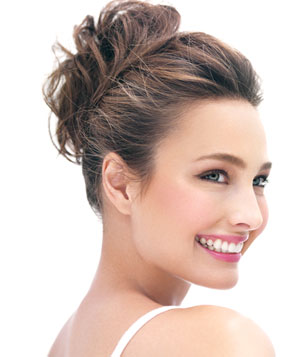 Profile of smiling model with pink lipstick and eyeshadow