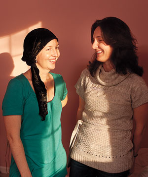 Cancer survivor standing in room with her friend