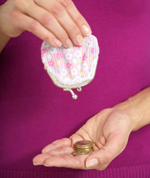 Woman emptying change purse