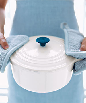 Woman holding a Dutch oven