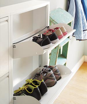Three-drawer shoe cabinet holding several pairs of shoes
