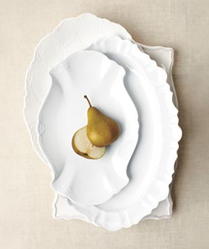 Sliced pears on white ceramic dishware