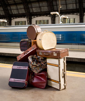 Large pile of luggage on train platform