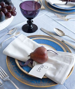 Place setting with red pear and name card
