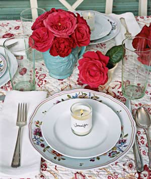Table setting with rose theme and name candle