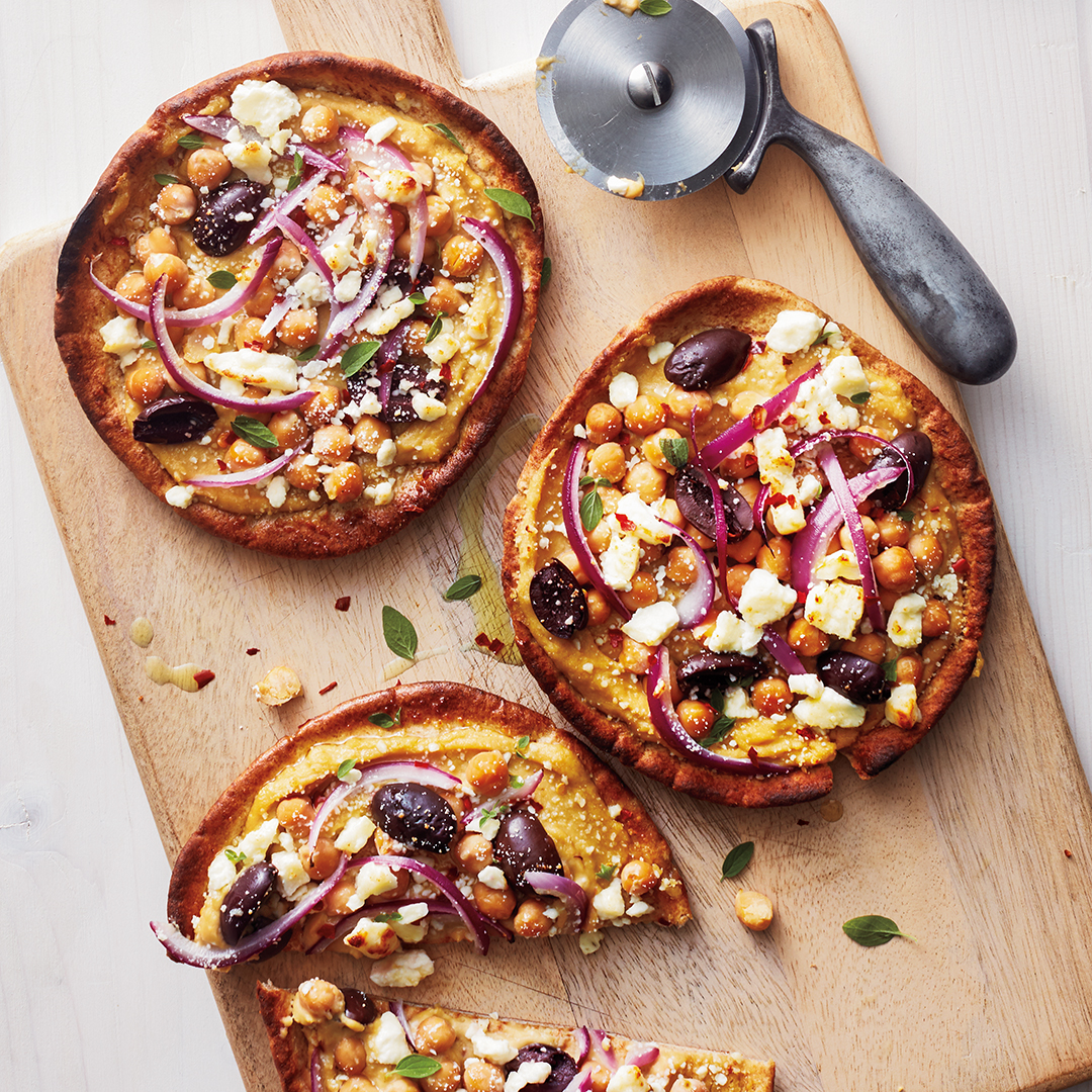 Pita pizzas with olives and feta