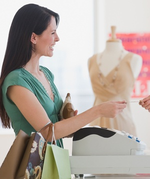 Woman paying for purchase at boutique