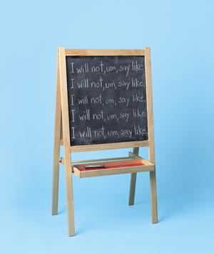 Writing on a chalkboard easle