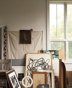Stacks of framed art cluttering up room