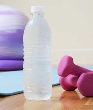 Balance ball, water bottle, and dumbbells