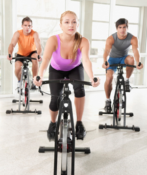Three people on stationary bikes