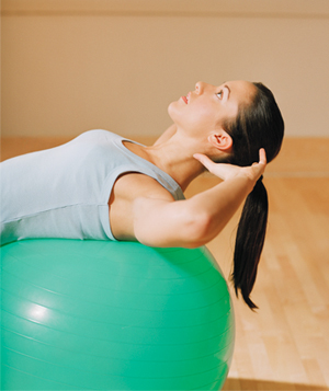Woman doing crunches on a balance ball