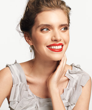 Model wearing warm red lipstick