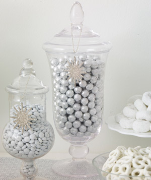 Clear jars filled with metallic and white candy
