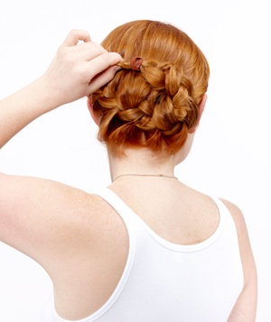 How to do a side french braid bun real simple step 3 of the side french braid bun ccuart Images