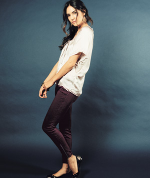 Model wearing eggplant colored jeans