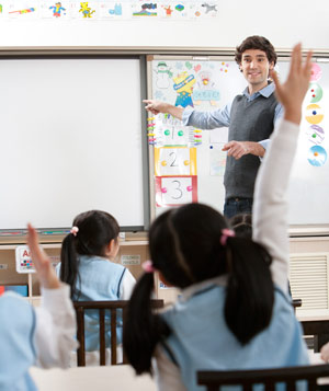 Man teaching young class