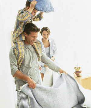 Family making bed
