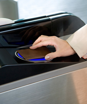 Woman swiping card at turnstile