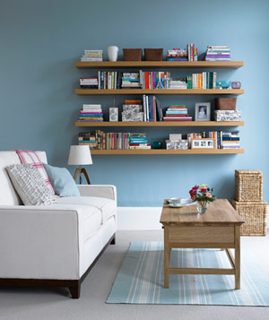 Light blue room with books on wall