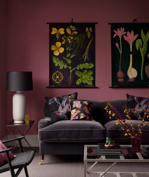 Purple room with floral artwork