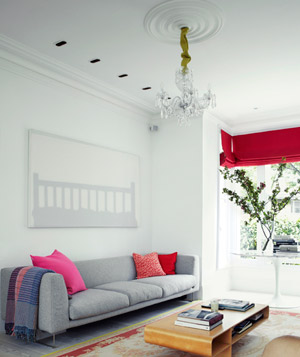 White and grey room with red decor
