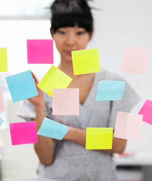Woman standing in front of Post-It notes