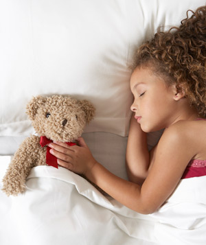 Little girl asleep with teddy bear