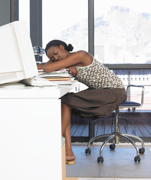 Woman sleeping on desk