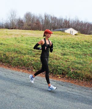 Woman running on a country road