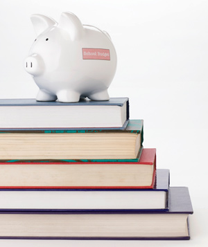 School budget piggy bank on top of books