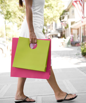 Woman carrying two shopping bags