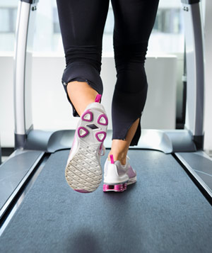 Woman's feet running on treadmill
