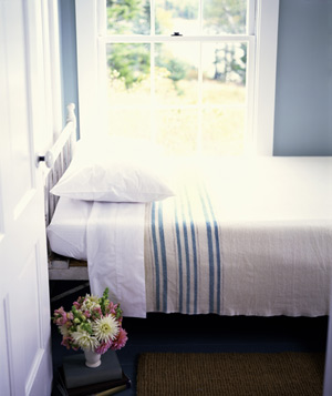 Bed in front of bright window