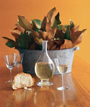 centerpiece made of leaves on a table with bread and wine