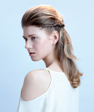 Model wearing a braided halo hairstyle