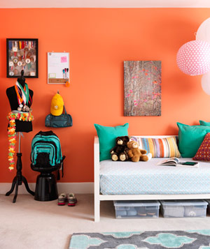 Daybed against coral colored wall